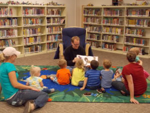 Children's librarian Chris reads a story at storytime on October 14, 2016.