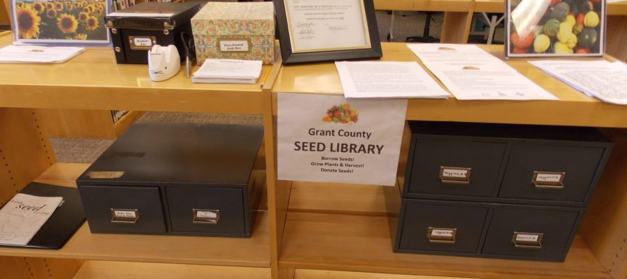 The files and paperwork for the Grant County Seed Library sit on shelves near the public library's information desk.