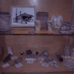 mineral specimens and an old photograph