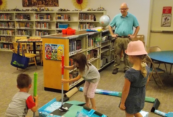 "Ken Dayer helps supervise ""library golf"" during the 2016 summer reading program."