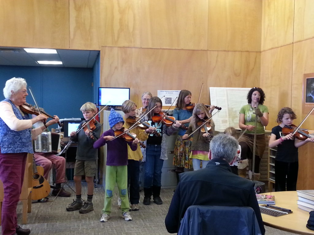 Kids playing the fiddle