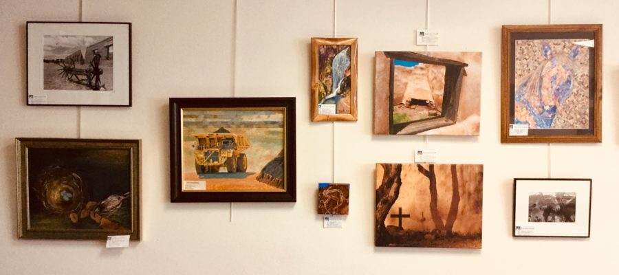 photo of a wall with nine works of art by members of the Grant County Art Guild