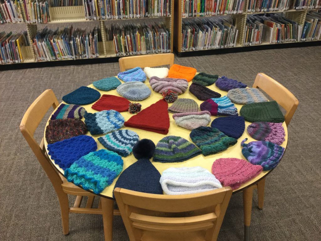 knit hats to be distributed to children at storytime, December 2018